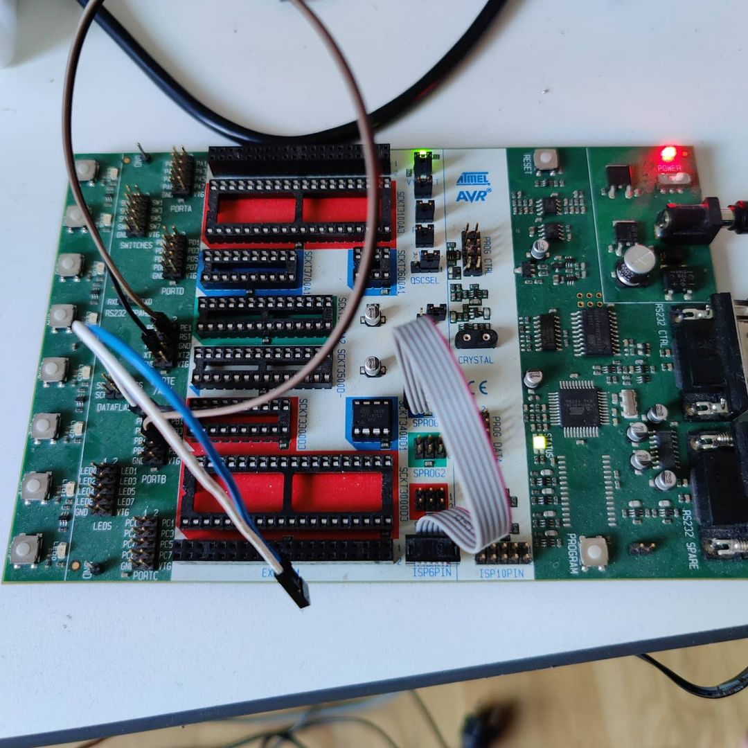 Atmel STK500 programmer board with ATTiny chip slotted